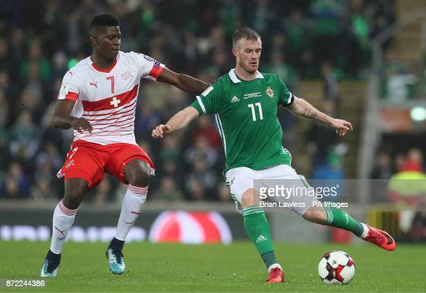 Switzerland's Breel Embolo and Northern Ireland's Chris Brunt in action during the 2018 World Cup Qualifying PlayOff First Leg match at Windsor Park...
