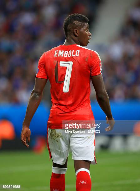 Switzerland's Breel Embolo with a ripped shirt
