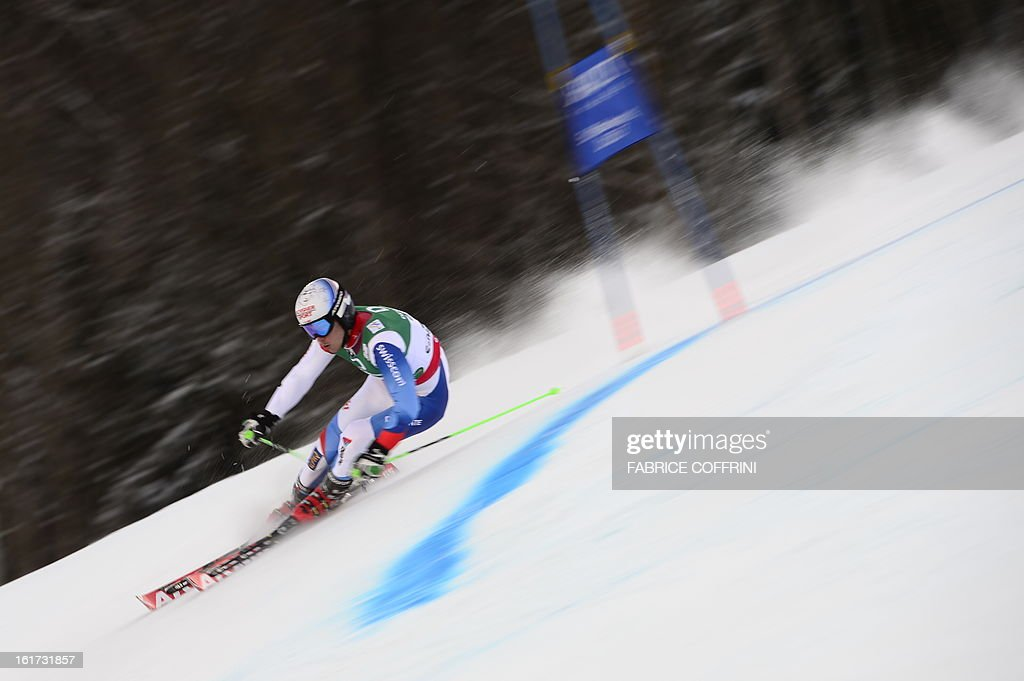 Switzerland's Carlo Janka skis during the first run of the men's Giant slalom at the 2013 Ski World Championships in Schladming, Austria on February 15, 2013. AFP PHOTO / FABRICE COFFRINI