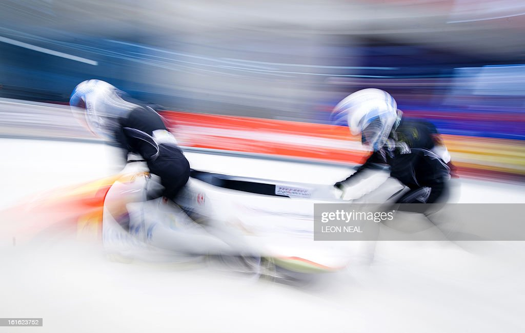Switzerland's Caroline Spahni (L) pushes off during a training run for the Bobsleigh Women category of the FIBT Bob and Skeleton World Cup 2012/23 at the Sanki sliding centre, near Rzhanaya Polyana on February 13, 2013. With a year to go until the Sochi 2014 Winter Games, construction work continues as tests events and World Championship competitions are underway.