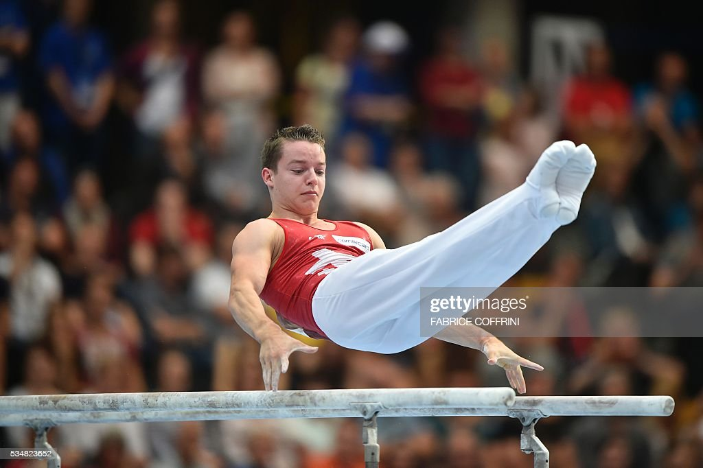Switzerland's Christian Baumann performs during the Mens Parallel Bars competition of the European Artistic Gymnastics Championships 2016 in Bern, Switzerland on May 28, 2016. / AFP / FABRICE