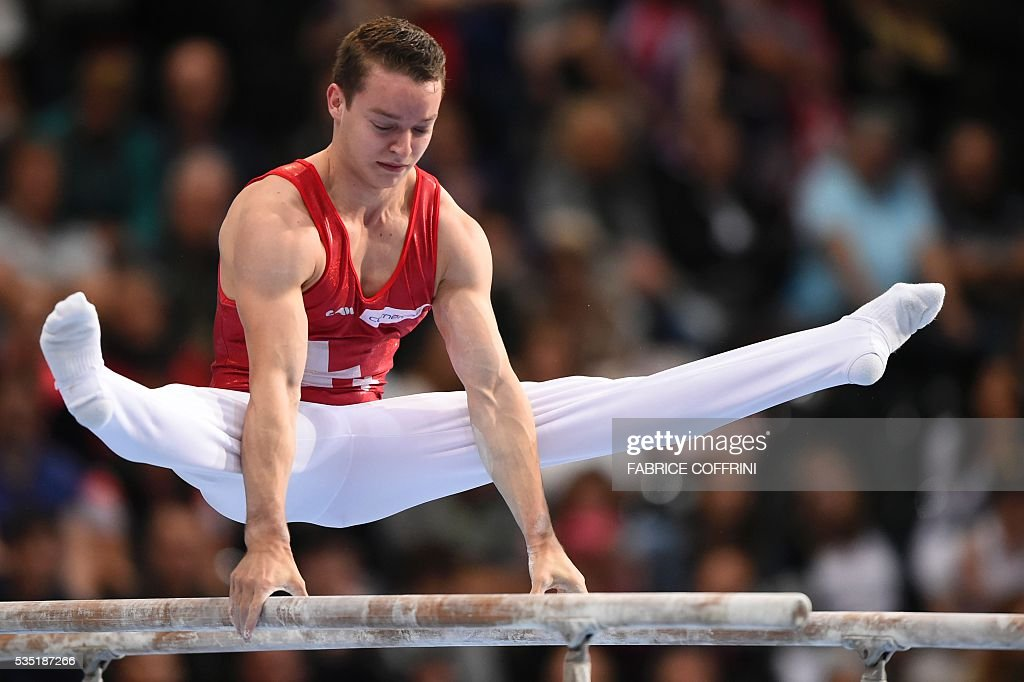 Switzerlands Christian Baumann performs during the Mens Parallel Bars competition of the European Artistic Gymnastics Championships 2016 in Bern, Switzerland on May 29, 2016. / AFP / FABRICE