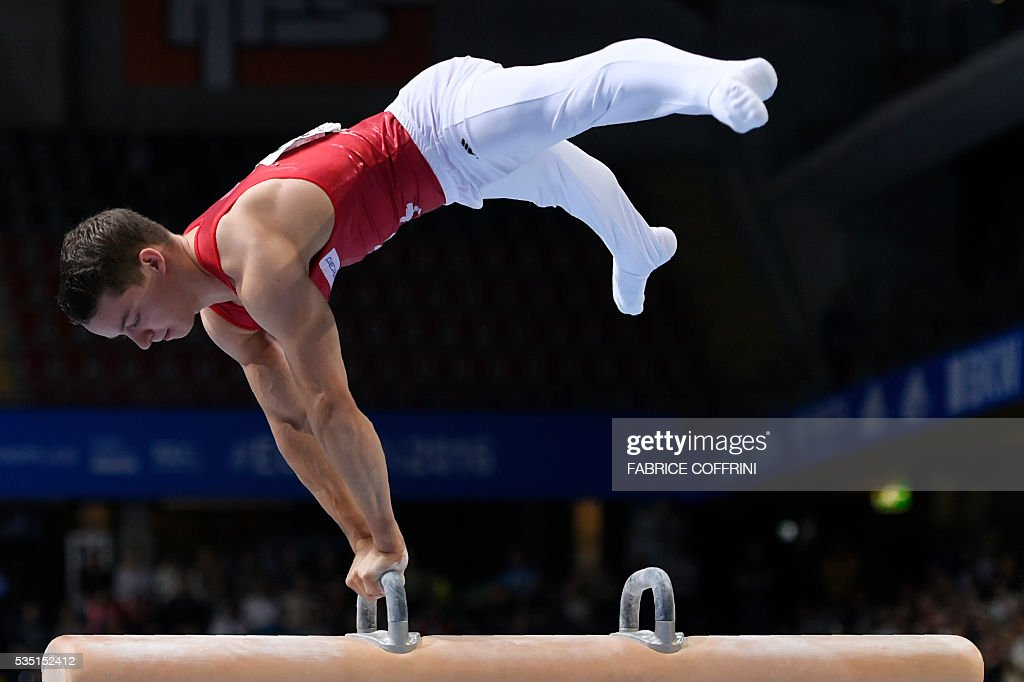 Switzerlands Christian Baumann performs during the Mens Pommel Horse competition of the European Artistic Gymnastics Championships 2016 in Bern, Switzerland on May 29, 2016. / AFP / FABRICE