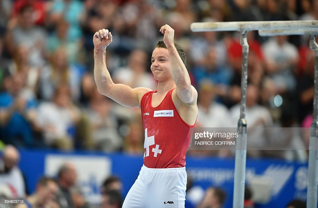 Switzerland's Christian Baumann reacts after the Mens Parallel Bars competition of the European Artistic Gymnastics Championships 2016 in Bern, Switzerland on May 28, 2016. / AFP / FABRICE