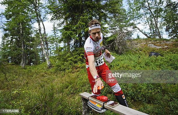 Switzerland's Daniel Hubmann competes to finish fifth in the men's middle distance final in the IOF World Orienteering Championships 2013 in Sotkamo...