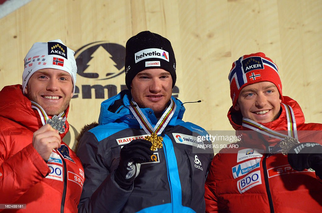 Switzerland's Dario Cologna (C) poses on February 23, 2013 with his gold medal next to second-placed Martin Johnsrud Sundby (L) of Norway and third-placed Sjur Roethe of Norway on the podium of the men's cross country 15 kms classic +15 km free Skiathlon race of the FIS Nordic World Ski Championships at the Val Di Fiemme Cross Country stadium in Cavalese, northern Italy.