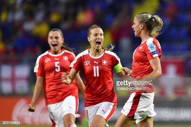 Switzerland's defender AnaMaria Crnogorcevic celebrates with teammates after scoring a goal during the UEFA Women's Euro 2017 football match between...