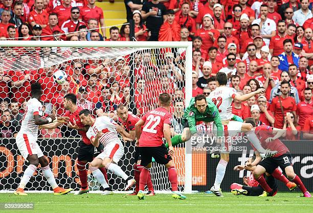 TOPSHOT Switzerland's defender Fabian Schaer scores a header during the Euro 2016 group A football match between Albania and Switzerland at the...