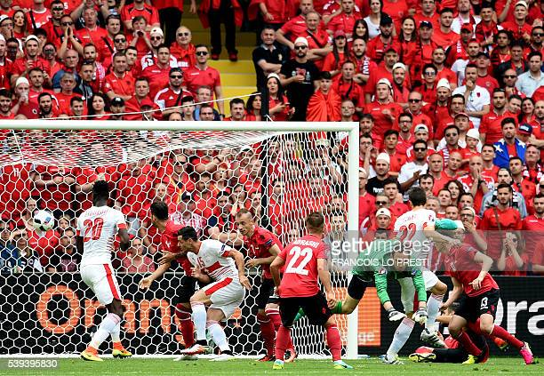 Switzerland's defender Fabian Schaer scores a header during the Euro 2016 group A football match between Albania and Switzerland at the...