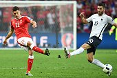 TOPSHOT Switzerland's defender Fabian Schaer vies for the ball against France's forward AndrePierre Gignac during the Euro 2016 group A football...