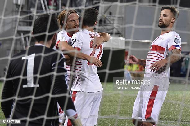 Switzerland's defender Fabian Schar celebrates with teammates after scoring a goal during the FIFA World Cup 2018 football qualifier between Andorra...