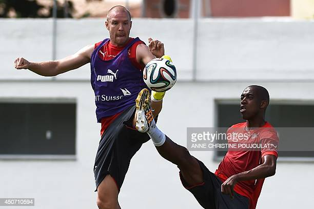 Switzerland's defender Philippe Senderos and Switzerland's midfielder Gelson Fernandes take part in a training session on June 16 2014 at the...