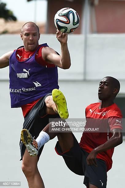 Switzerland's defender Philippe Senderos and Switzerland's midfielder Gelson Fernandes a training session on June 16 2014 at the Municipal Stadium in...