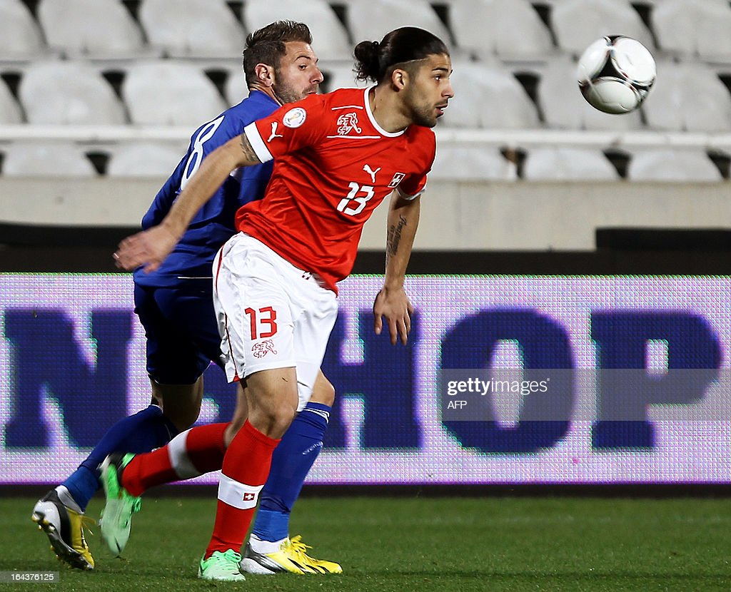 Switzerland's defender Ricardo Rodriguez (R) challenges Cyprus' midfielder Anthos Solomou during the 2014 World Cup European zone group E qualifying football match between Cyprus and Switzerland at GSP Stadium in Nicosia on March 23, 2013.