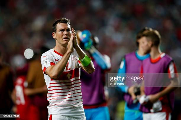 Switzerland's defender Stephan Lichtsteiner applauds the supporters at the end of the FIFA World Cup WC 2018 football qualifier match between...
