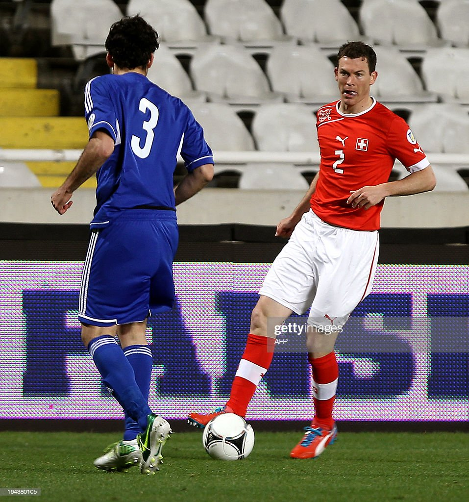 Switzerland's defender Stephan Lichtsteiner (R) challenges Cyprus' defender Elias Charalambous during the 2014 World Cup European zone group E qualifying football match between Cyprus and Switzerland at GSP Stadium in Nicosia on March 23, 2013. The match ended in a goalless draw.