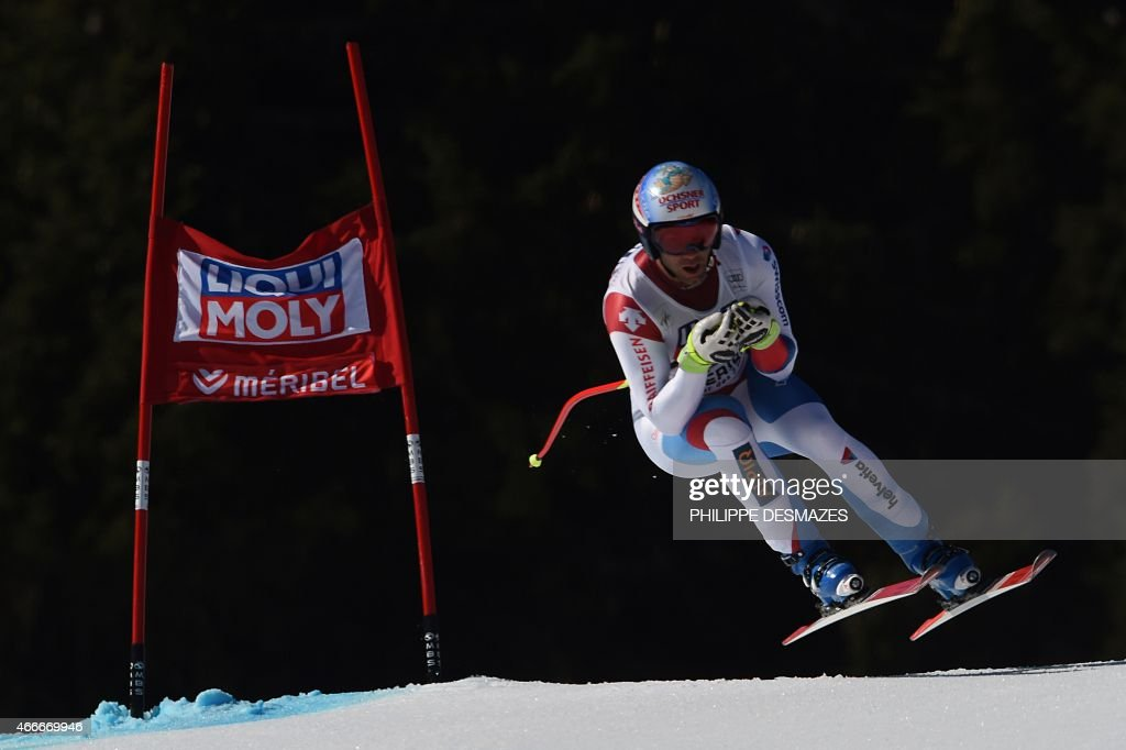 Switzerland's <a gi-track='captionPersonalityLinkClicked' href=/galleries/search?phrase=Didier+Defago&family=editorial&specificpeople=241278 ng-click='$event.stopPropagation()'>Didier Defago</a> competes in the Men's downhill at the FIS Alpine Skiing World Cup finals in Meribel on March 18, 2015. AFP PHOTO / PHILIPPE DESMAZES