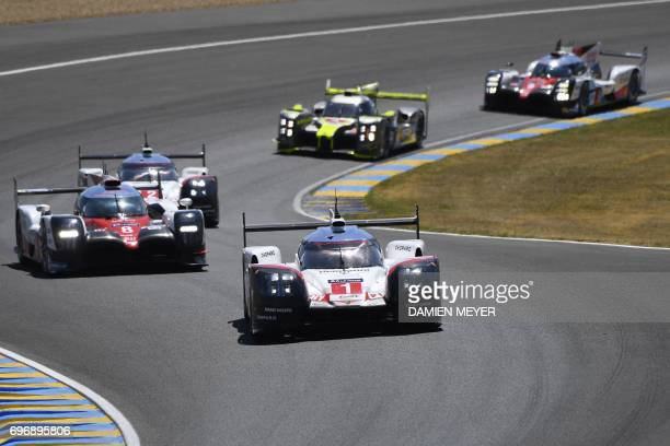 Switzerland's driver Neel Jani competes on his Porsche 919 Hybrid N°1 ahead of Switzerland's driver Sebastien Buemi on his Toyota TS050 Hybrid N°8...