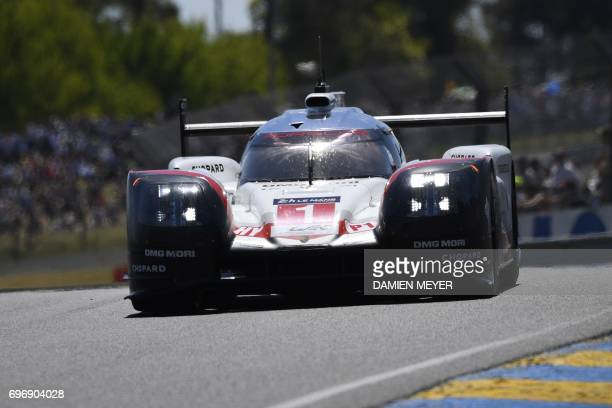 Switzerland's driver Neel Jani competes on his Porsche 919 Hybrid N°1 as he takes the start of the 85th Le Mans 24hours endurance race on June 17...
