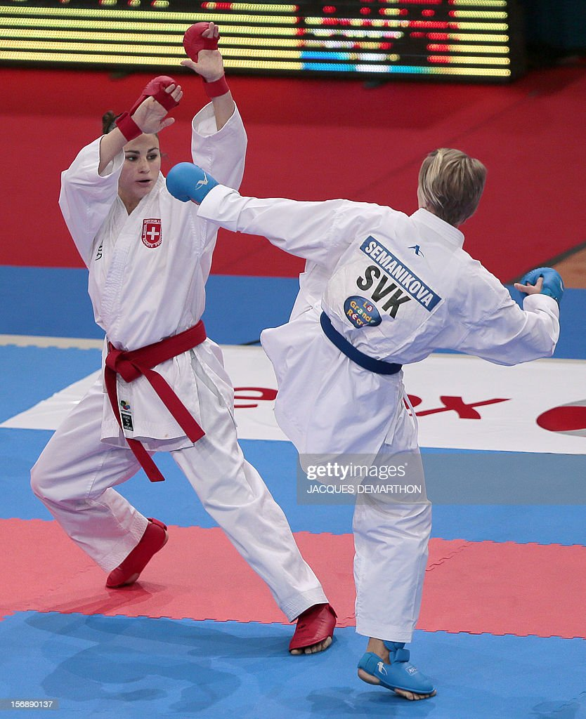 Switzerland's Elena Quirici (L) fights against Slovakia's Viktoria Semanikova (R) in the women's under 61 kg category during the 2012 World Karate Championships on November 24, 2012 in Paris. Quirici won the bronze medal. DEMARTHON