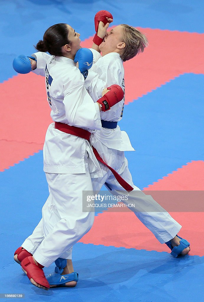 Switzerland's Elena Quirici (L) fights against Slovakia's Viktoria Semanikova (R) in the women's under 61 kg category during the 2012 World Karate Championships on November 24, 2012 in Paris. Quirici won the bronze medal.