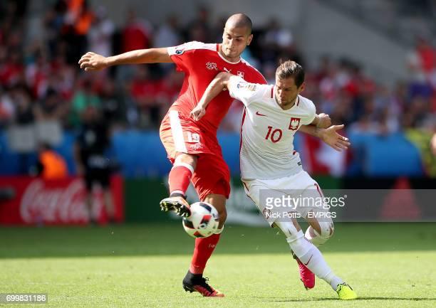 Switzerland's Eren Derdiyok and Poland's Grzegorz Krychowiak battle for the ball