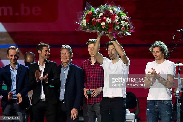 Switzerland's Fabian Cancellara holds a bouquet of flowers next to Belgium's Edward Theuns Luxembourg's Frank Schleck UCI ProTour Team RadioShack's...