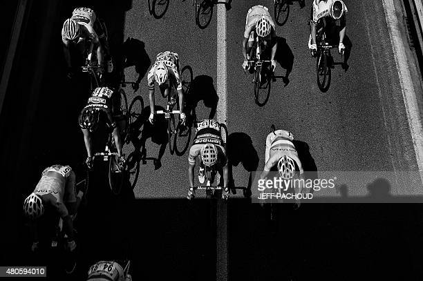 Switzerland's Fabian Cancellara wearing the overall leader's yellow jersey rides in the pack during the 1595 km third stage of the 102nd edition of...