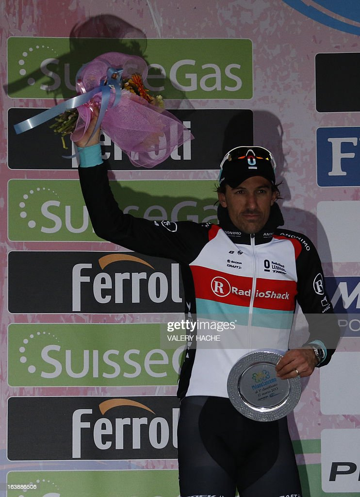 Switzerland's Fabian Cancellera poses on the third step of the podium after the104th Milan San Remo spring classic cycling race on March 17, 2013 in San Remo. Gerald Ciolek of Germany, riding for South African team MTN-Qhueka, won the first cycling classic of the season, the Milan-Sanremo, triumphing in a race curtailed by heavy snow.