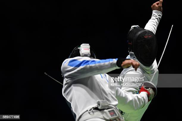 Switzerland's Fabian Kauter competes against Italy's Paolo Pizzo during the mens team epee quarterfinal bout between Italy and Switzerland as part of...