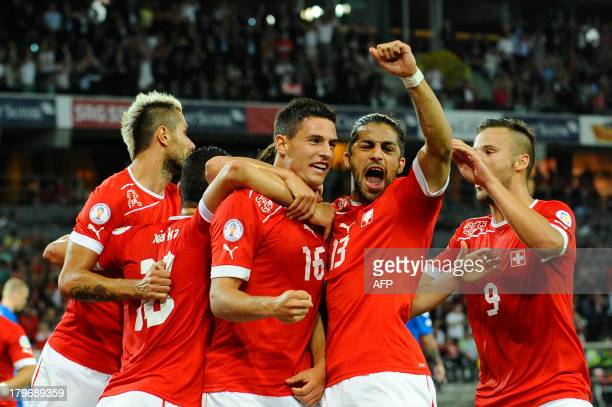 Switzerland's Fabian Schar celebrate after scoring during a FIFA World Cup 2014 qualifying football match Switzerland vs Iceland at the Stade de...