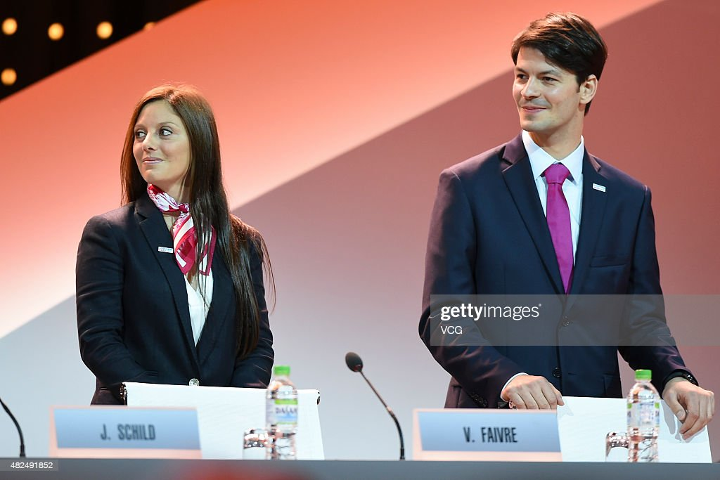 Switzerland's figure skater <a gi-track='captionPersonalityLinkClicked' href=/galleries/search?phrase=Stephane+Lambiel&family=editorial&specificpeople=247248 ng-click='$event.stopPropagation()'>Stephane Lambiel</a> (R) and ski champion <a gi-track='captionPersonalityLinkClicked' href=/galleries/search?phrase=Virginie+Faivre&family=editorial&specificpeople=786060 ng-click='$event.stopPropagation()'>Virginie Faivre</a> speak during the bid presentation to host the 2020 Youth Winter Olympics in the Swiss city of Lausanne at the 128th IOC session on July 31, 2015 in Kuala Lumpur, Malaysia.