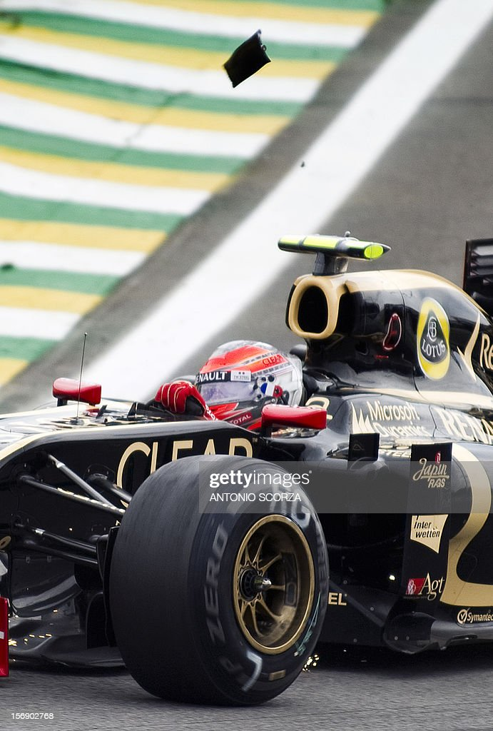 Switzerland's Formula One driver Romain Grosjean powers his damaged car during the qualifying session for tomorrow's Brazilian GP, on November 24, 2012 at the Interlagos racetrack in Sao Paulo, Brazil. AFP PHOTO