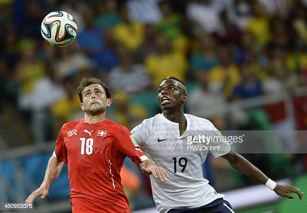 Switzerland's forward Admir Mehmedi vies with France's midfielder Paul Pogba during a Group E football match between Switzerland and France at the...