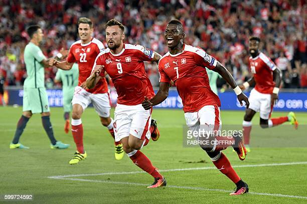 Switzerland's forward Breel Embolo celebrates his team's first goal with teammate forward Haris Seferovic during the World Cup 2018 football...