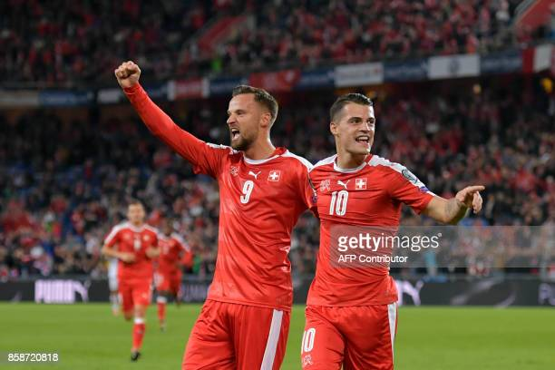 Switzerland's forward Haris Seferovic and midfielder Granit Xhaka celebrate a goal during the FIFA World Cup WC 2018 football qualifier match between...