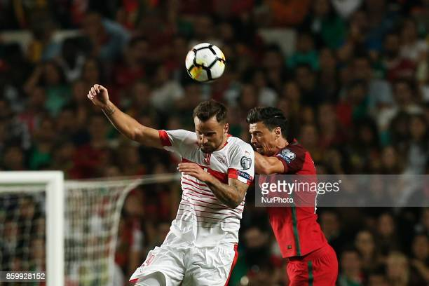 Switzerland's forward Haris Seferovic heads for the ball with Portugal's defender Jose Fonte during the FIFA World Cup WC 2018 football qualifier...