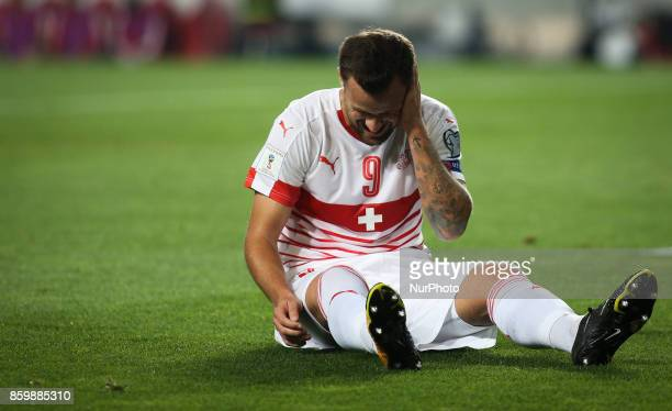 Switzerland's forward Haris Seferovic reacts during the FIFA 2018 World Cup Qualifier match between Portugal and Switzerland at the Luz Stadium on...