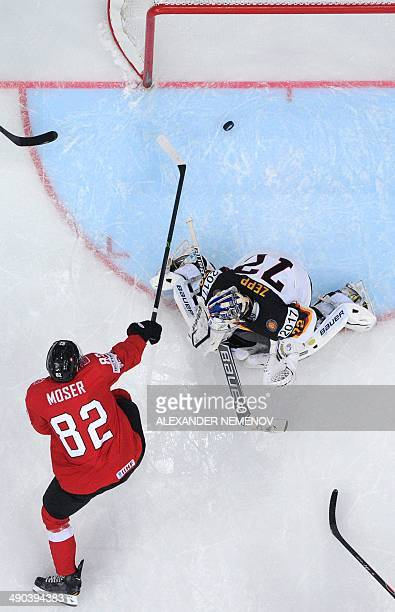 Switzerland's forward Simon Moser guides the puck passed Germany's goalkeeper Rob Zepp during a IIHF International Ice Hockey World Championship...