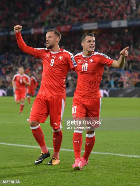 Switzerland's foward Haris Seferovic and teammate midfielder Granit Xhaka celebrate a goal during the FIFA World Cup 2018 football qualifier match...