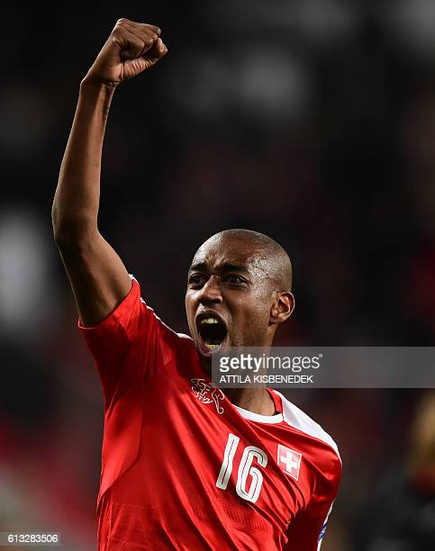 Switzerland's Gelson Fernandes celebrates winning the World Cup 2018 football qualification match between Hungary and Switzerland at the Groupama...