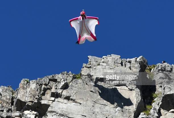 Switzerland's Geraldine Fasnacht jumps from the top of the Brevent mountain to fly in wingsuit over the French ski resort of Chamonix on July 16 2014...
