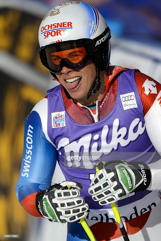 Switzerland's Gino Caviezel reacts after placed 11th in the men's giant slalom race at the FIS Alpine Skiing World Cup in Adelboden on January 12, 2013. AFP PHOTO / FABRICE COFFRINI