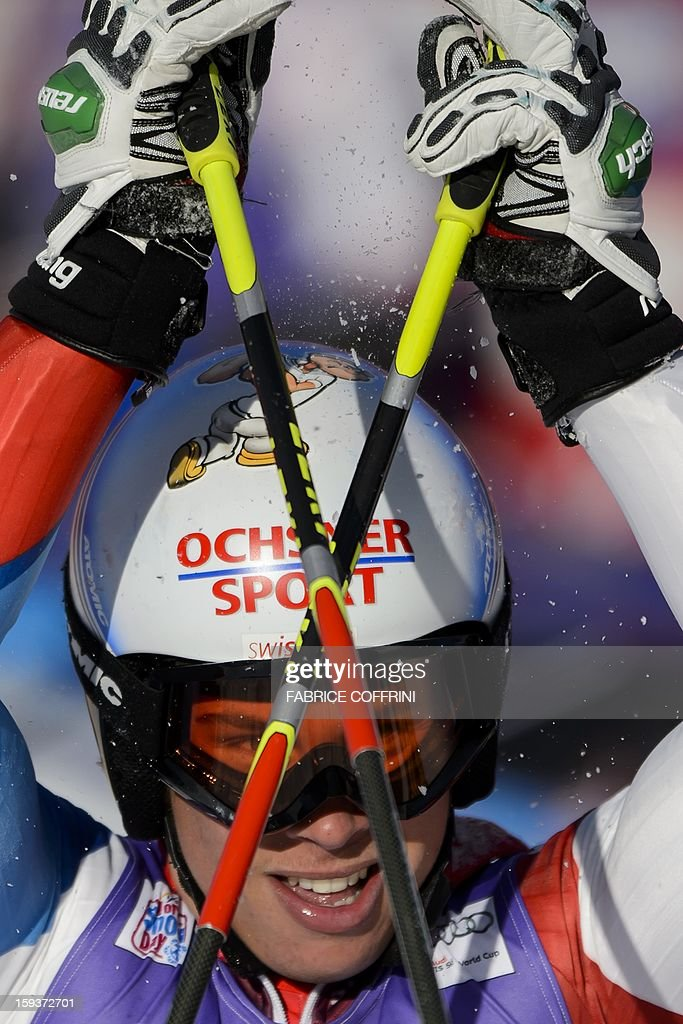 Switzerland's Gino Caviezel reacts after placed 11th in the men's giant slalom race at the FIS Alpine Skiing World Cup in Adelboden on January 12, 2013.