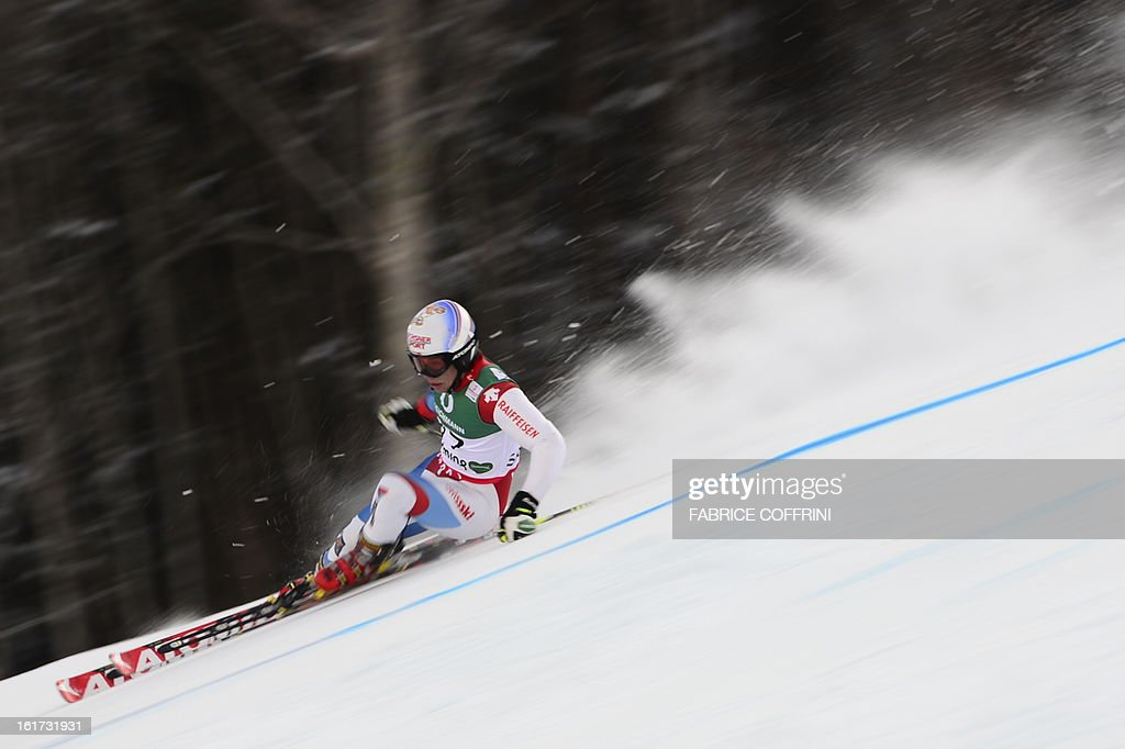 Switzerland's Gino Caviezel skis during the first run of the men's Giant slalom at the 2013 Ski World Championships in Schladming, Austria on February 15, 2013. AFP PHOTO / FABRICE COFFRINI