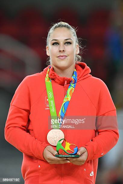 Switzerland's Giulia Steingruber celebrates with her bronze medal on the podium for the women's vault event final of the Artistic Gymnastics at the...