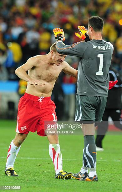 Switzerland's goalkeeper Diego Benaglio and Switzerland's defender Stephane Grichting celebrate after the Group H first round 2010 World Cup football...