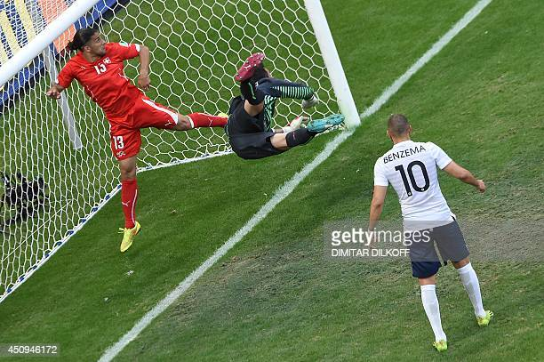 Switzerland's goalkeeper Diego Benaglio fails to stop a ball shot by France's forward Olivier Giroud during a Group E football match between...