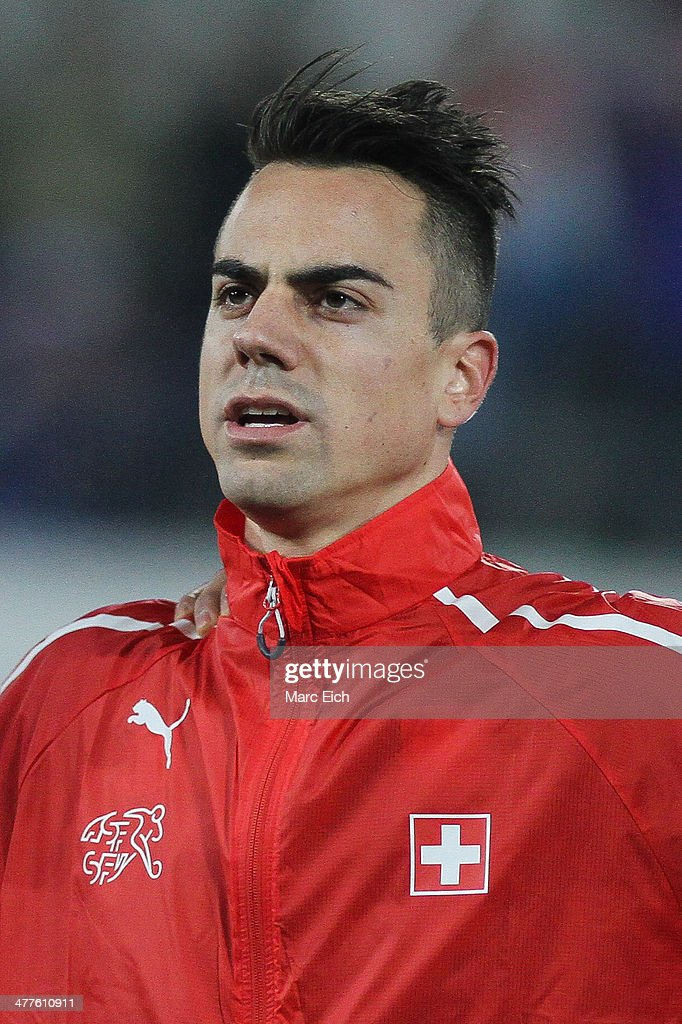 Switzerland's goalkeeper <a gi-track='captionPersonalityLinkClicked' href=/galleries/search?phrase=Diego+Benaglio&family=editorial&specificpeople=543817 ng-click='$event.stopPropagation()'>Diego Benaglio</a> stands for the national anthem prior the international friendly match between Switzerland and Croatia at the AFG Arena on March 5, 2014 in St Gallen, Switzerland.