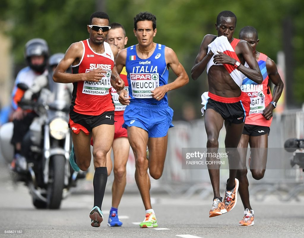 Switzerland's Gold medalist Tadesse Abraham, Italy's bronze medalist Daniele Meucci and Turkey's silver medalist Kaan Kigen Ozbilen compete the men's Half Marathon during the European Athletics Championships in Amsterdam, on July 10, 2016. / AFP / FABRICE